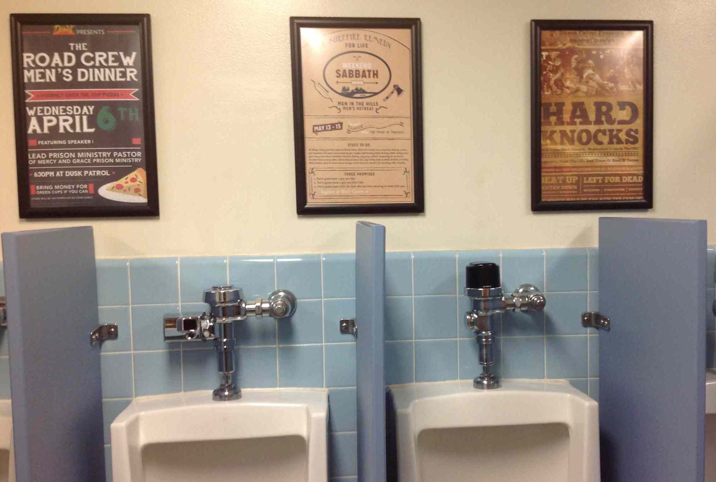 Men's Church Activity Posters On Restroom Wall
